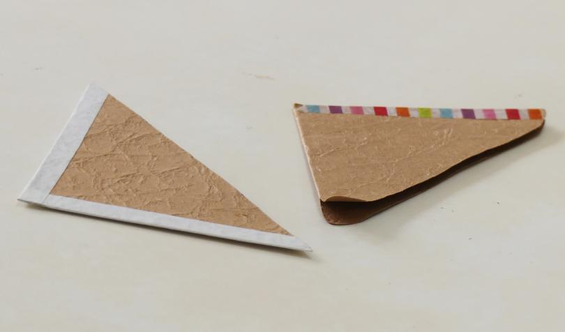 紙がめくるのを防ぐアイテム